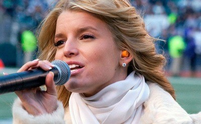 Jessica Simpson is performing The National Anthem at NFC Championship Playoff Game, circa 2003.