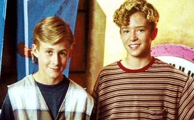 Young Ryan Gosling and Justin Timberlake are posing together for a Mickey Mouse Club photo.