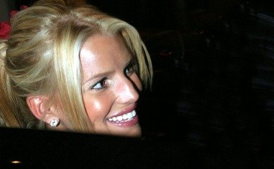 Jessica Simpson is entering the car, during Jessica Simpson and Nick Lachey visit to Drew Lachey Broadway Debut, in New York.